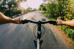 Bike riding on a road. First person view Stock Photo