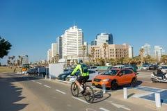 Bike riding on a seaside promenade in Tel Aviv, Israel Royalty Free Stock Images