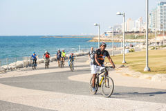 Bike riding on a seaside promenade in Tel Aviv, Israel Royalty Free Stock Image