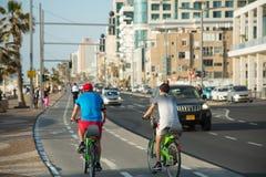 Bike riding on a seaside promenade in Tel Aviv, Israel Stock Image