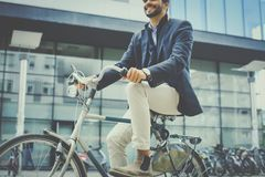 Bike riding after work. Business man riding bike on street. Close up Royalty Free Stock Photo