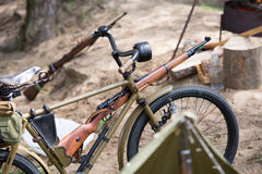 Bike with rifle Royalty Free Stock Photo