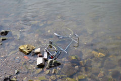 Bike in river - water pollution Stock Photos