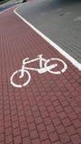 Bike road. Sign on the sidewalk Stock Photography