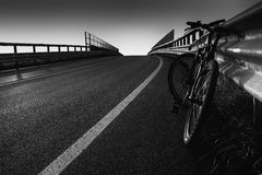 Bike. On road near a bridge Stock Photos