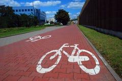 Bike road sign. On pavement Stock Photo