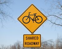 Bike Road Sign. A road sign saying shared road with bikes and cars Royalty Free Stock Photography