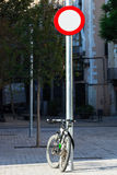 Bike and a road sign. In the city Stock Photography