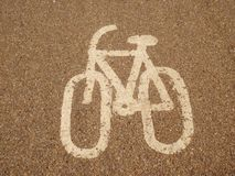 Bike road sign - cool looking. Cool looking bike sign painted on the road track. can be used as background or in infographics Stock Images