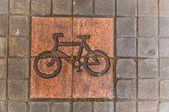 Bike road sign. On pavement Royalty Free Stock Images