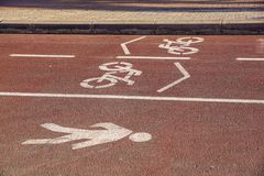 Bike road sign on the street, bicycle lane sign on street,. Bike road sign on the street, bicycle lane sign on street Royalty Free Stock Photo