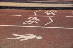 Bike road sign on the street, bicycle lane sign on street,. Bike road sign on the street, bicycle lane sign on street Stock Images