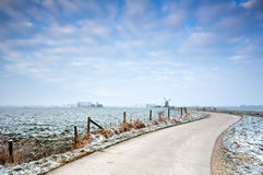 Bike road to the windmill in winter Royalty Free Stock Photos
