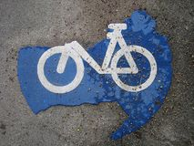 Bike route sign. Closeup of a bike route sign on pavement Stock Images