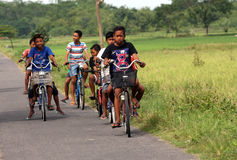 Bike. Rural children in Sukoharjo, Central Java, Indonesia using a bicycle to travel Stock Image