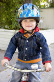 Bike safety. Boy wearing helmet rides tricycle - see 6734793 for isolated version of this photo stock photos