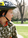 Bike safety. Child in helmet learning how to ride a bike Royalty Free Stock Image
