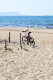 Bike on a sandy beach Royalty Free Stock Images