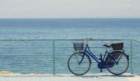 The bike and the sea. The bike and the blue sea Royalty Free Stock Images