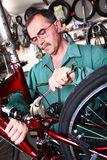 Bike service. Service for bike with adept repairing bike Stock Photography