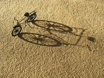 Bike Shadow. A bike with its shadow seen from above Stock Photos