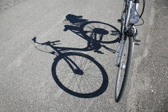 Bike and shadow Stock Images