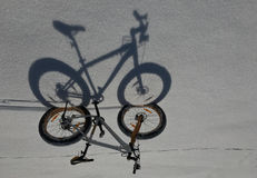 Shadow of snow bicycles Stock Images