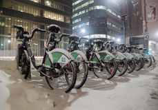 Bike Share Bikes Covered in Snow in Toronto Stock Image