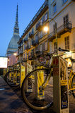Bike sharing station and Mole Antonelliana in Turin, Italy Royalty Free Stock Images