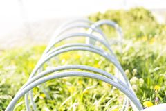 Bike shed with grass in sunshine Royalty Free Stock Photography