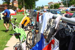 Bike Shoes Hanging On Fence. Bike Across Kansas participants stop for the day in a small town where they make use of a school fence to air laundry and shoes Royalty Free Stock Images