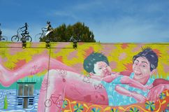 Bike Shop Art in Portland, Oregon. This is the painted wall of a bike shop in Portland, Oregon with bicycle sculptures on the roof Stock Photos