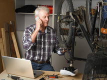 Bike shop owner at work Royalty Free Stock Image