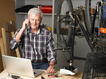 Bike shop owner at work Royalty Free Stock Images