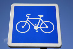 Bike Sign. Blue cycle lane sign on blue sky background Stock Image