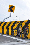 Bike and sign arrow. Curve arrow sign and bike Royalty Free Stock Image