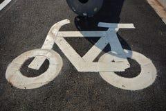 Bike sign. In asphalt road Stock Image