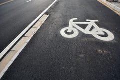 Bike sign. In asphalt road Royalty Free Stock Images