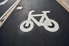Bike sign. In asphalt road Royalty Free Stock Photo