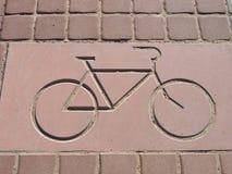 Bike sign on brick Royalty Free Stock Image