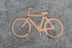 Bike sign etched into the pavement. Bicycle sign engraved into the pavement of pike path in Portland, Oregon. Top down view stock photo