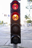 Bike sign in red and yellow light Royalty Free Stock Image