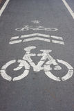 Bike sign on the road bike way Stock Photos