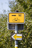Bike sign and tourist directorz Royalty Free Stock Images
