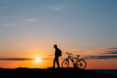 The bike silhouette in the mountains. Stock Photos
