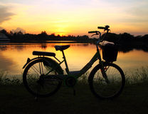 Bike silhouette in the river Stock Photography