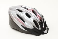 Bike silver helmet. Side view of silver plastic unisexs bicycle helmet for adults close up on white background Stock Image