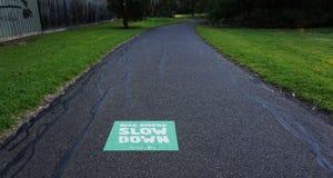 Bike Slow Down Sign on Asphalt stock photo