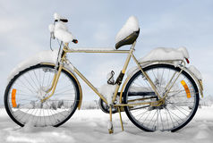 Bike in snow Stock Images