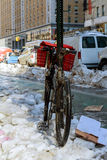 Bike in the snow at New York city with Manhattan, New York Royalty Free Stock Images